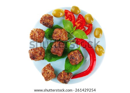 meatballs on blue dish with pepper and tomatoes - stock photo
