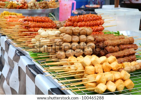 Meatballs on sticks at a market in Phuket, Thailand - stock photo