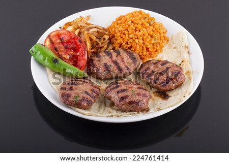 Meatballs or Burger with salad and garnish - stock photo