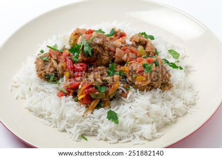 Meatballs Smyrna  cooked with a sauce of cumin, red and yellow capsicums and tomatoes, making a colourful and tasty dish - stock photo