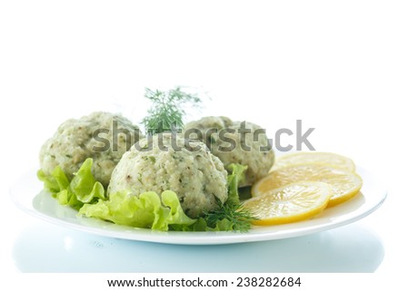 meatballs steam fish with greens on a white background - stock photo