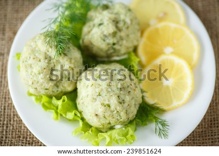 meatballs steam fish with greens on a white plate - stock photo