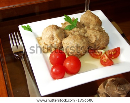 meatballs whit onion sauce and cherry tomatoes - stock photo