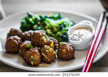 Meatballs with green salad and honey mustard sauce - stock photo