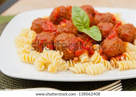 Meatballs with homemade tomato sauce and pasta rotini. selective focus