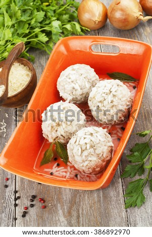 Meatballs with rice in the ceramic pot