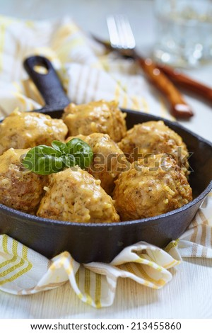 Meatballs with riceand vegetable on a pan - stock photo
