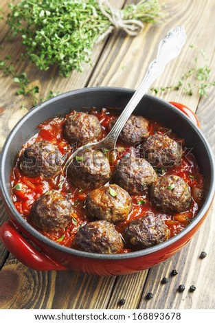 Meatballs with tomato sauce in a pan - stock photo