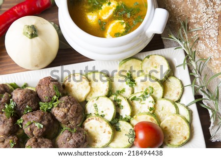 Meatballs, zucchini and carrot soup close up - stock photo