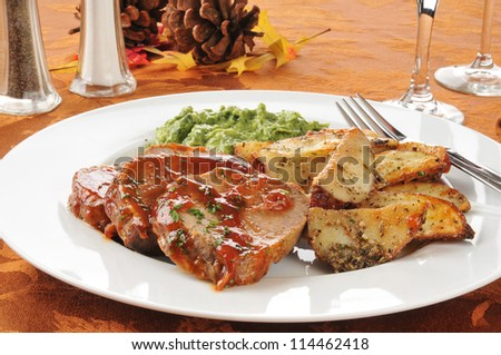 Meatloaf and potato dinner on a festive holiday table setting