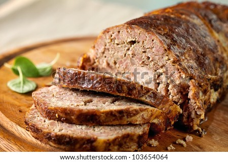 Meatloaf (beef) with salad on a wooden platter - stock photo