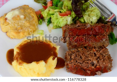 Meatloaf, mashed potatoes and gravy, buttered biscuit and tossed green ...