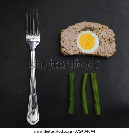 meatloaf with egg - stock photo