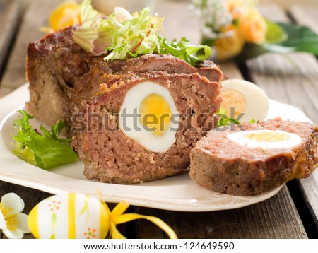 Meatloaf with egg for easter dinner, selective focus - stock photo
