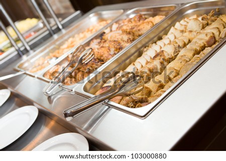 Meats and plates ready on a banquet - stock photo