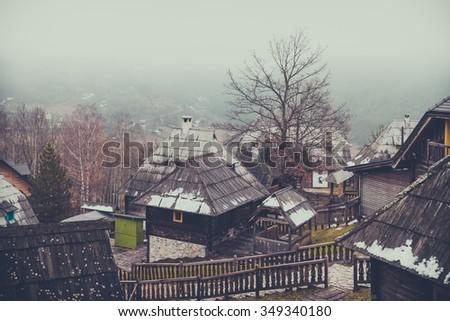 Mecavnik of Drvengrad village on Mokra Gora mountain, Serbia. Soft and selective focus, strong clarity, grain texture visible on maximum size - stock photo
