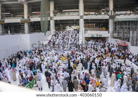 MECCA - DECEMBER 22, 2014 : Muslim pilgrims exit the mosque after prayer  in Mecca, Kingdom of Saudi Arabia. Muslims around the world face the Kaaba during prayer time.