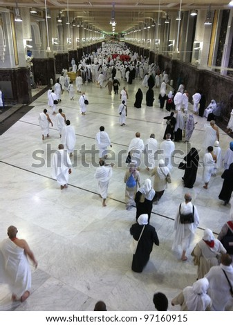 MECCA-FEB.26: Muslim pilgrims perform saei (brisk walking) from Safa mount from Marwah mount on February 26, 2012 in Mecca. Muslim pilgrims perform 7 rounds of saei from Safa mount to Marwah mount. - stock photo