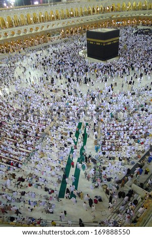 MECCA - JULY 7 : Crowd of pilgrims circumambulate around Kaaba on July 7, 2011 in Mecca,Saudi Arabia. Pilgrims circumambulate seven times to show their submission to the religion. - stock photo