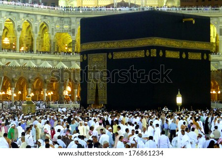 MECCA - JULY 7: Crowd of pilgrims circumambulate around Kaaba on July 7, 2011 in Mecca,Saudi Arabia. Pilgrims circumambulate seven times to show their submission to the religion.  - stock photo