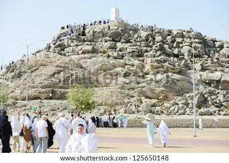 MECCA - JULY 21 : Jabal Arafat near Kaaba on July 21, 2012 in Mecca, Saudi Arabia.  Kaaba in Mecca is the holiest and most visited mosque for all Muslims and Arafat is a part of Hajj activities. - stock photo