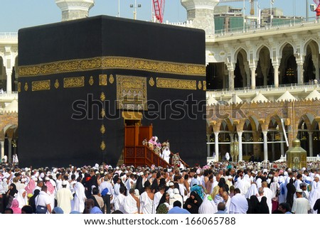 MECCA - JULY 2 : Pilgrims waiting for kaaba cleaning ceremony on July 2, 2011 in Mecca. The ceremony takes place roughly one month before the start of Ramadan and one month before the start of Hajj. - stock photo