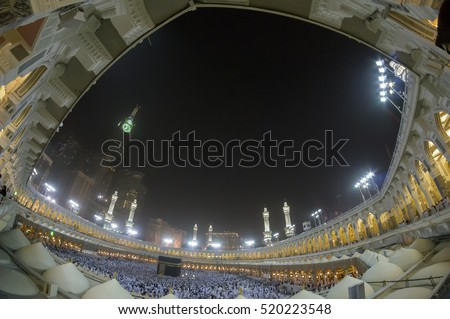 MECCA, S.ARABIA-CIRCA FEB 2012: Fisheye view of Kaabah and Abraj Al Bait (Royal Clock Tower Makkah) in Makkah. The tower is the tallest clock tower in the world at 601m.