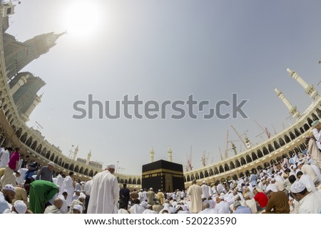 MECCA, S.ARABIA-CIRCA FEBRUARY 2012:Fisheye view of Muslims ready for prayer in Makkah. Abraj Al Bait (Royal Clock Tower Makkah) is on the left.