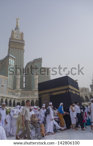 MECCA, S.ARABIA-JUN 5:Abraj Al Bait (Royal Clock Tower Makkah)(lefT) on June 5, 2013 in Makkah. The tower is the tallest clock tower in the world at 601m (1972 feet), built at a cost of USD1.5 billion - stock photo