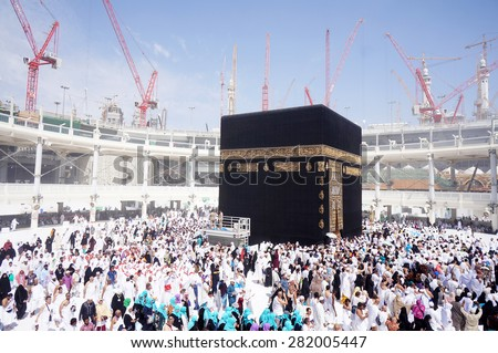 MECCA, SAUDI ARABIA-CIRCA MAY 2015: Muslims are doing tawaf around the Kaaba in Masjidil Haram in Makkah, Saudi Arabia. The mosque is under construction to expand the space for hajj