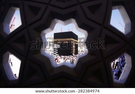 MECCA, SAUDI ARABIA-CIRCA MAY 2015: Muslims are doing tawaf around the Kaaba in Masjidil Haram on MAY, 2015 in Makkah, Saudi Arabia. Muslims all around the world come here doing umrah and hajj