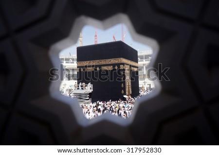 MECCA, SAUDI ARABIA-CIRCA MAY 2015: Muslims are doing tawaf around the Kaaba in Masjidil Haram on MAY, 2015 in Makkah, Saudi Arabia. Muslims all around the world come here doing umrah and hajj - stock photo