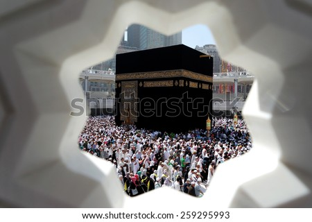 MECCA, SAUDI ARABIA - FEBRUARY 4: Muslim pilgrims, from all around the World, revolving around the Kaaba on February 4, 2015 in Mecca, Saudi Arabia. Muslim people praying together at holy place.