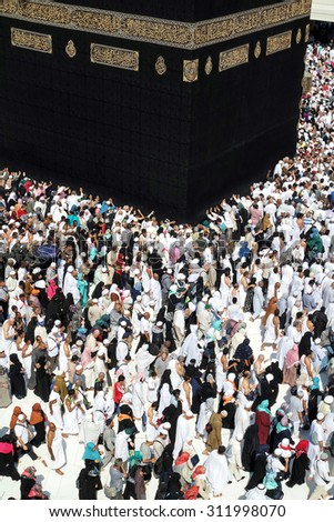 MECCA, SAUDI ARABIA - FEBRUARY 2: Muslim pilgrims, from all around the World, revolving around the Kaaba on February 2, 2015 in Mecca, Saudi Arabia. Muslim people praying together at holy place. - stock photo