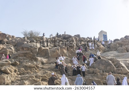 MECCA, SAUDI ARABIA - MAR 11: Muslims at Mount Arafat (or Jabal Rahmah) March 11, 2015 in Arafat, Saudi Arabia. This is the place where Adam and Eve met after being overthrown from heaven.