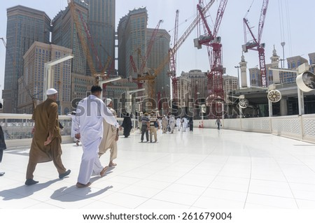 MECCA, SAUDI ARABIA - MAR 10 : Muslims tawaf from upper mataf at Haram Mosque March 10, 2015 in Makkah. The mosque expansion scheduled to complete in 2 years to accommodate more pilgrims.  - stock photo