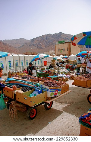 Mecca, Saudi Arabia - May 3 2007: Local market selling dates and carpet - stock photo