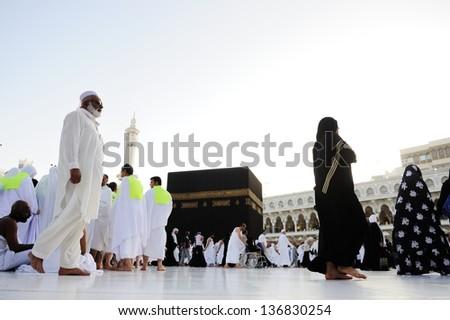 MECCA, SAUDI ARABIA - MAY 24: Muslim pilgrims, from all around the World, are circumambulating the Kaaba on May 24, 2012 in Mecca, Saudi Arabia. - stock photo