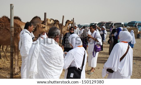 MECCA, SAUDI ARABIA - MAY 23:  Muslims pilgrims visit camel farm. Usually touring agency will include camel farm as a place to visit. May 23, 2013 in Mecca. - stock photo