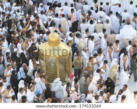 MECCA, SAUDI ARABIA - OCTOBER 13: Muslim pilgrims, from all around the World, revolving around the Kaaba on October 13, 2013 in Mecca, Saudi Arabia. - stock photo