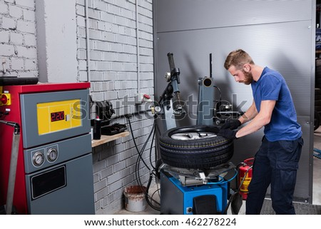 Mechanic changing car wheel.
