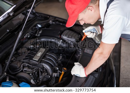 Mechanic changing oil - stock photo