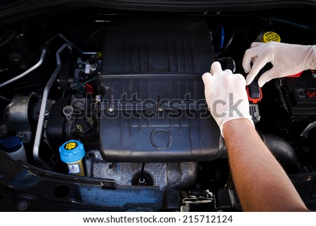 mechanic checks auto electronic control unit, ecu - stock photo