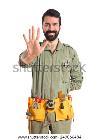 Mechanic counting five  - stock photo