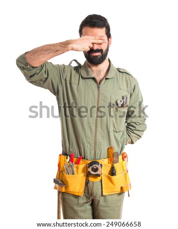Mechanic covering his eyes  - stock photo