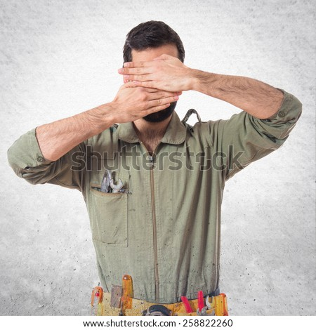 Mechanic covering his face  - stock photo