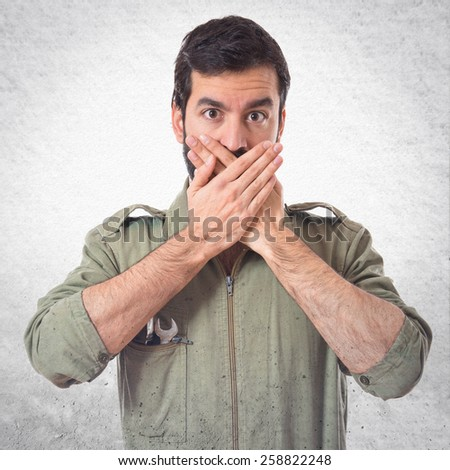 Mechanic covering his mouth  - stock photo