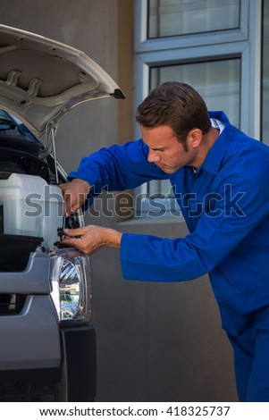 Mechanic examining the car at the repair garage
