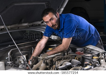 Mechanic fixing an old car