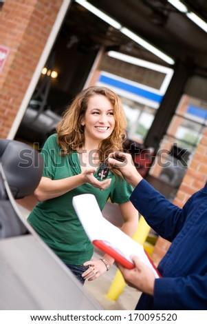 Mechanic: Giving keys to customer. - stock photo
